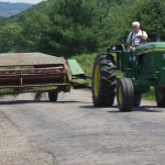 John bringing the tractor back to the barn