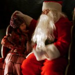 Child telling Santa what she wants for Christmas
