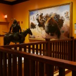 "Visions of the West Gallery at the Rockwell Museum - sculpture ""On the Warpath"" by Cyrus Dallin and painting ""The Buffalo Hunt"" by William R. Leigh"