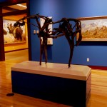 "The Wilderness Gallery, sculpture by Deborah Butterfield, ""Untitled and painting ""In the Bighorn Country"" by Carl Rungius"
