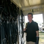 John Walsh and polo equipment inside trailer