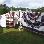 Amish Quilts waiting to be auctioned