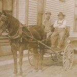 Two men  in horse drawn cart - courtesy of the Tioga Point Museum
